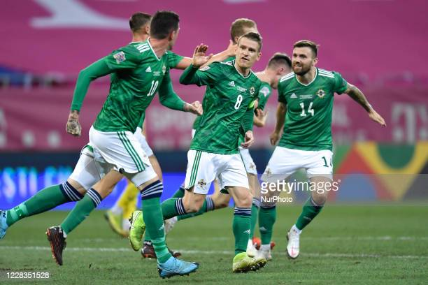 Gavine Whyte and Steven Davis of Northern Ireland celebrate during the game UEFA Nations League 2021 match between Romania and Northern Ireland at...