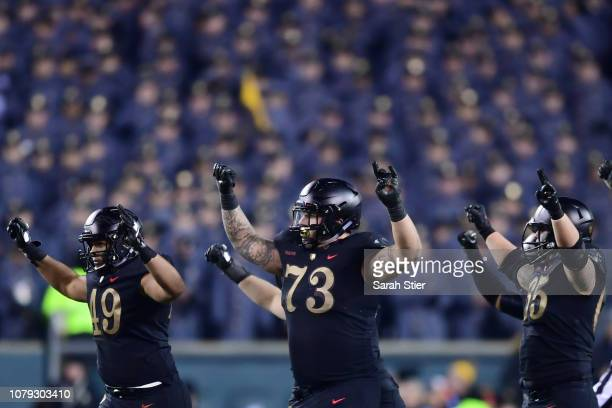 Gavyn Jones Jaxson Deaton and Bryce Holland of the Army Black Knights celebrate a first down at the end of the third quarter during the game against...
