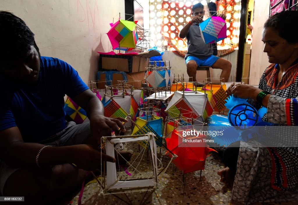 Gawde family members prepare around 600 'Aakash Kandil' made of paper and cane for upcoming Diwali Festival at Matunga, on October 5, 2017 in Mumbai, India.