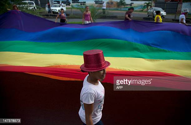 Gay activists march in Managua against homophobia and demanding a new family code legalizing the union of persons of the same sex on June 28 2012 AFP...