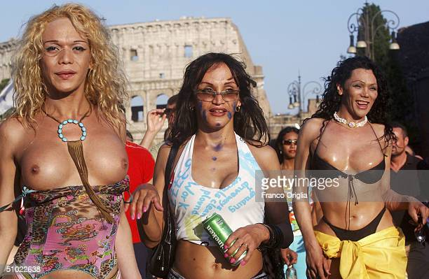 A gay and lesbian parade group marches in front at the Colosseum during the 10th Gay Pride Parade July 3 in Rome Italy The parade is part of a World...