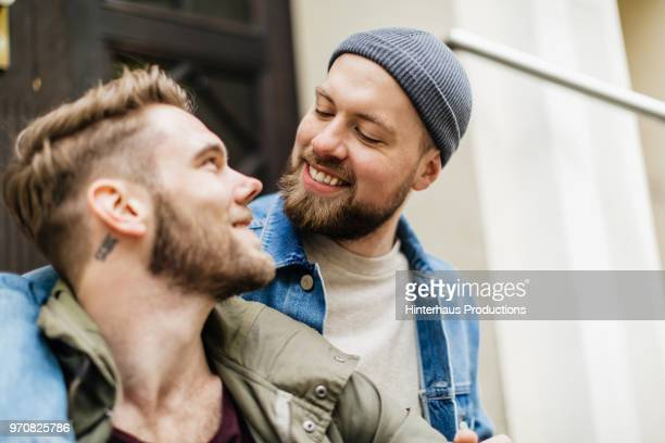 Gay Couple Affectionately Looking At One Another