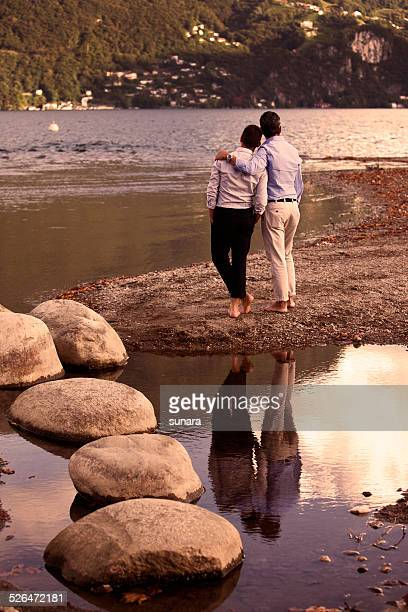 gay couple at sunset - human relationship stock pictures, royalty-free photos & images