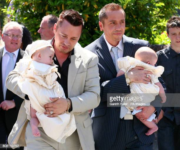 Gay couple Barrie and Tony DrewittBarlow carry their new twins Jasper and Dallas away from St John the Baptist Church in Danbury Essex following...