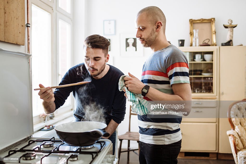 Gay Couple Cooking Together : Stock Photo