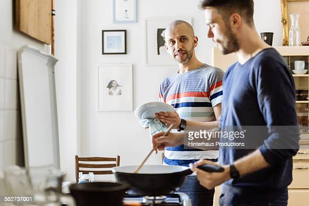 Gay Couple Doing Housework Together