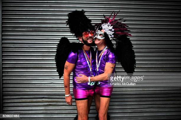 A gay couple embrace as they watch the Belfast Gay Pride march taking place on August 5 2017 in Belfast Northern Ireland The province is the only...