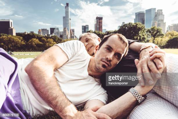 gay couple embracing in central park