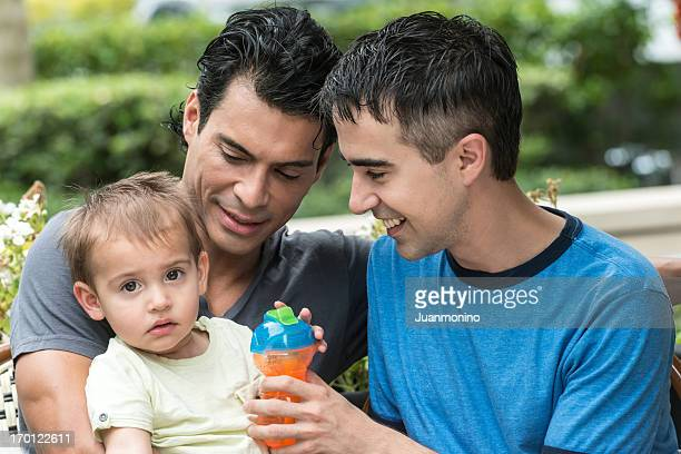 Gay couple enjoying time with toddler