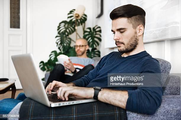 Gay Couple Enjoying Togetherness In livingroom
