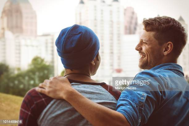 gay couple hanging out at the park - piedmont park atlanta georgia stock pictures, royalty-free photos & images