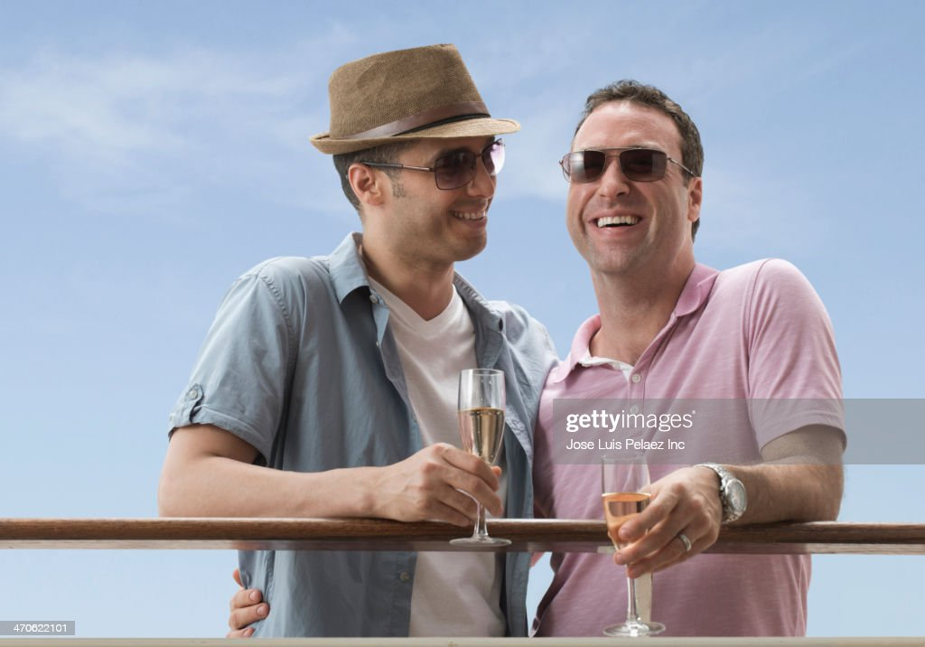Gay Couple Having Champagne On Cruise Ship Stock Photo Getty Images - Gay cruise ship