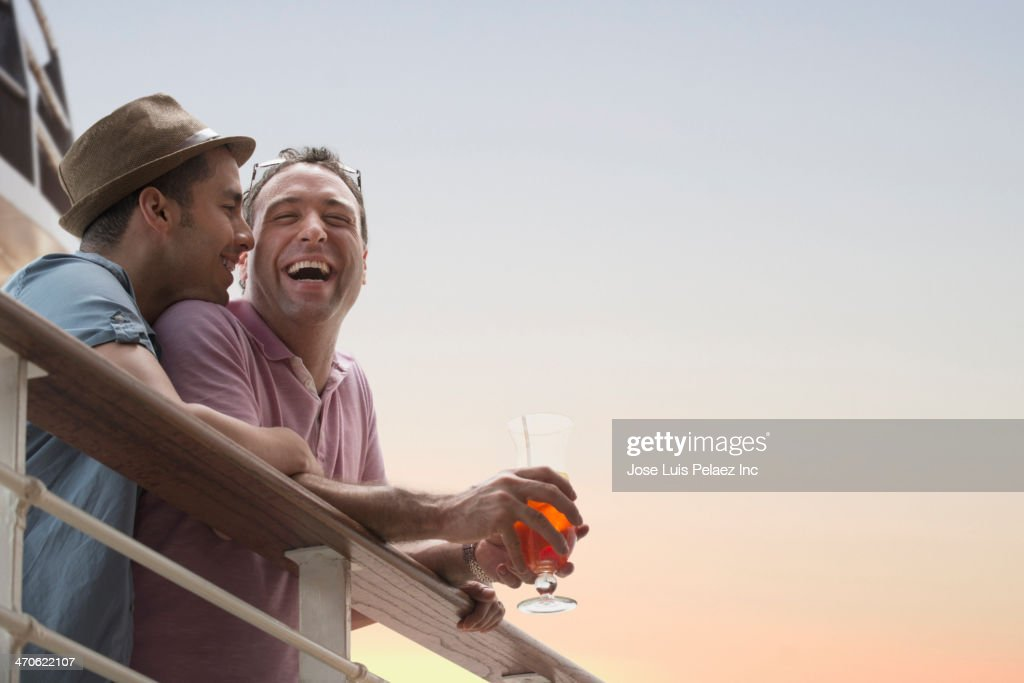 Gay Couple Having Drinks On Cruise Ship Deck Stock Photo Getty - Gay cruise ship