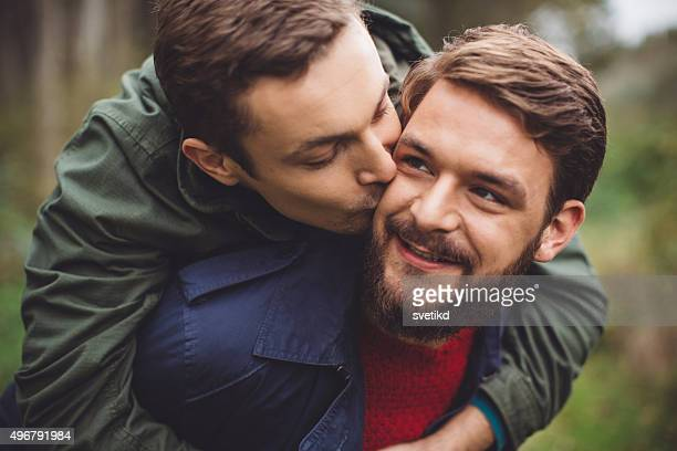 Gay couple having fun outdoor.