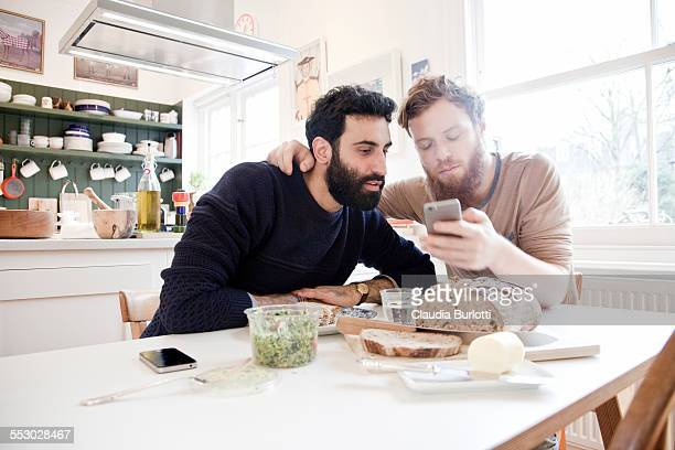 Gay couple having lunch at home