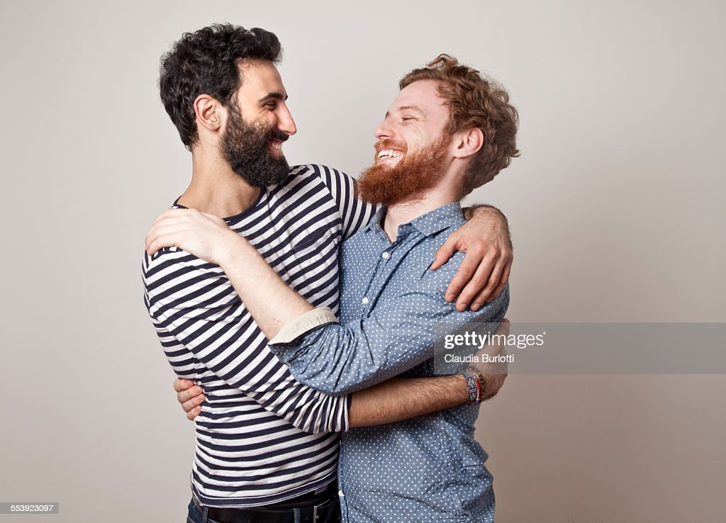 Gay couple hugging and laughing : Stock-Foto