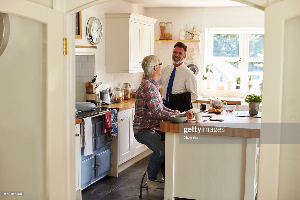 Gay Couple In Kitchen, One Leaving For Work, Full Length : Stock Photo