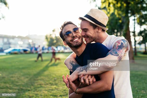 Gay couple in park hugging