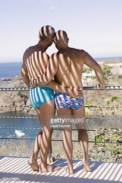 gay couple in swimsuits - gay men swimwear stock pictures, royalty-free photos & images