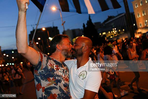 SQUARE ATHENS ATTICA GREECE A gay couple kiss in Syntagma Square with the Greek Parliament in the background at the 10th Athens Gay Pride Parade...