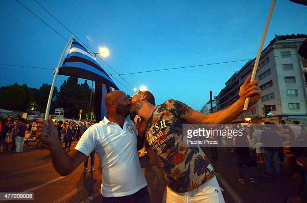 A gay couple kissing during the Gay Pride Parade LGBT community of Greece organized Athens Pride Festival in Athens to promote the their rights