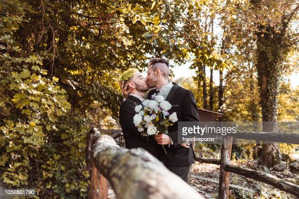 gay couple kissing for the marriage - gay person stock pictures, royalty-free photos & images