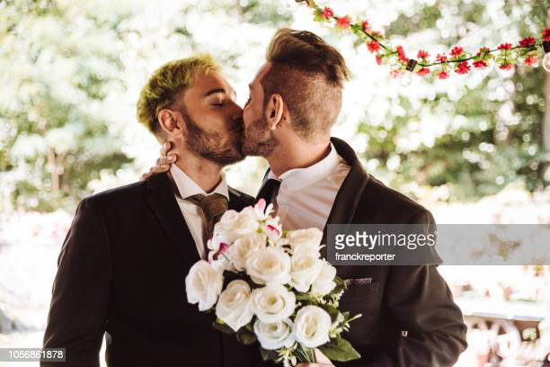 gay couple kissing for the marriage - civil partnership stock pictures, royalty-free photos & images