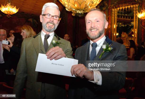 Gay couple Neil Allard and Andrew Wale show off their marriage certificate following their marriage outside Brighton's Royal Pavilion shortly after...