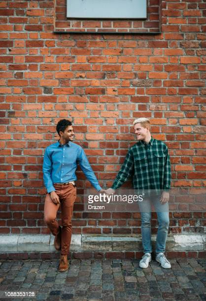 gay couple on city break - latino and scandinavian gay men enjoying their common life together - human relationship stock pictures, royalty-free photos & images