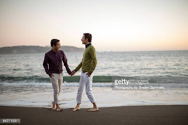 gay couple on san francisco beach. -  lgbtqi ストックフォトと画像