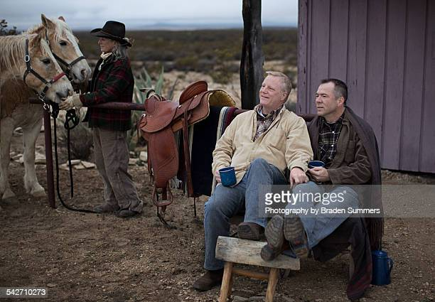 Gay couple on Texas ranch relaxing.