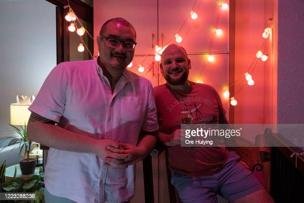 A gay couple pose for a portrait in their home decorated with pink light to show support to the LGBTQ community on June 27 2020 in Singapore Due to...