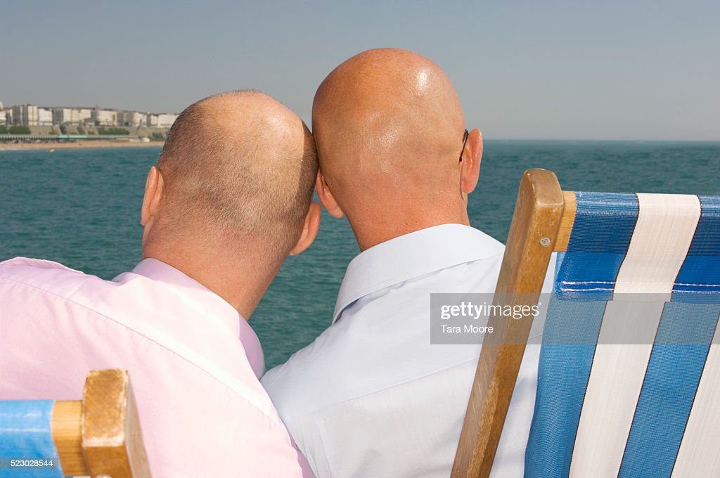Gay Couple Relaxing on Beach : Stock Photo