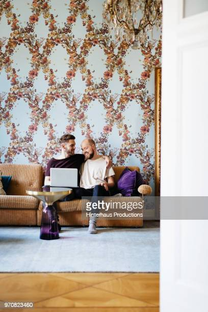 Gay Couple Relaxing On Couch Together