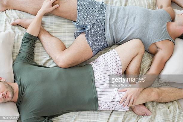 gay couple sleeping - shorts stock pictures, royalty-free photos & images