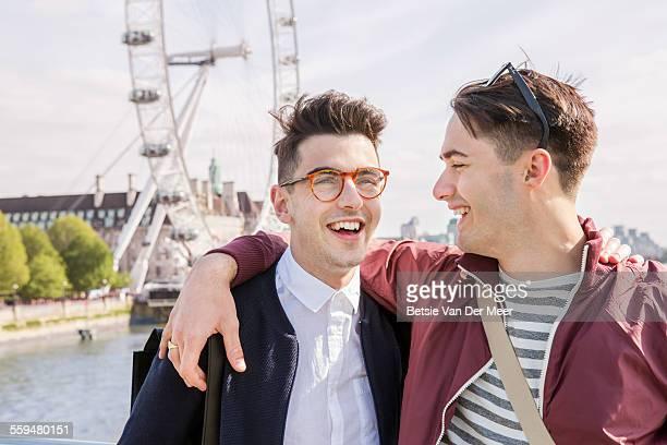 gay couple standing near London Eye