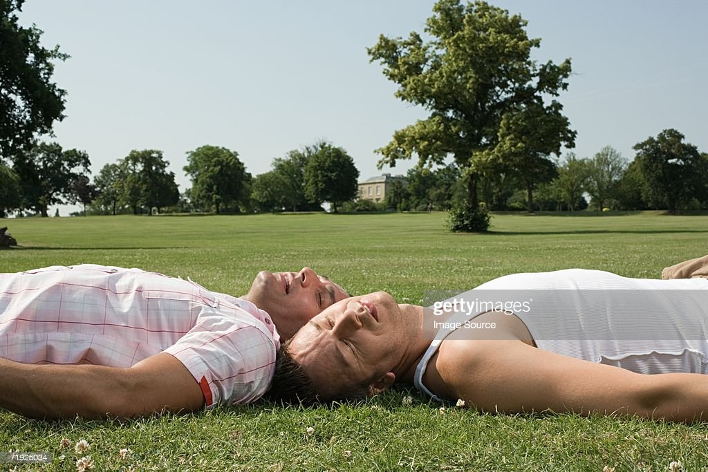Gay Couple Sunbathing Stock Photo