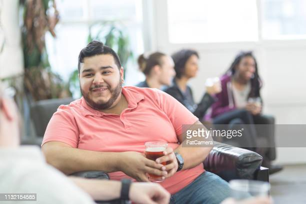 Gay couple talking during happy hour at a modern lounge