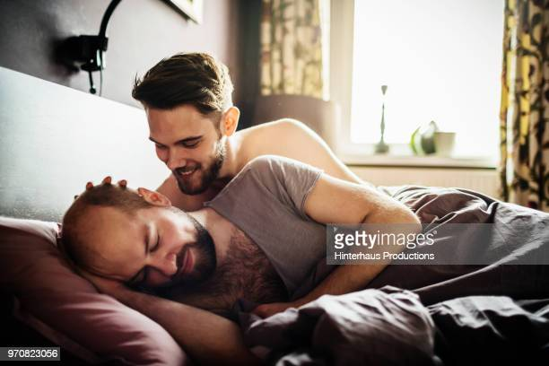 Gay Couple Talking In Bed
