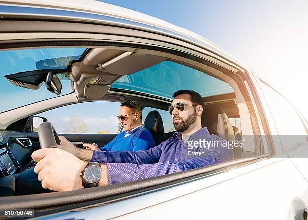 gay couple traveling by car - front passenger seat stock photos and pictures