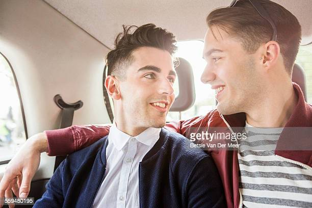 Gay couple travels by London cab