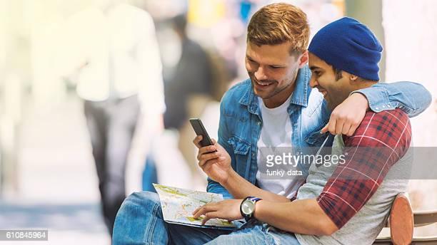 Gay couple using navigation