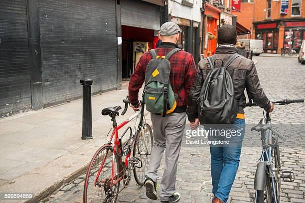 Gay couple walking through Temple Bar