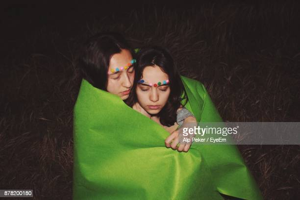 Gay Couple Wrapped In Green Fabric On Field