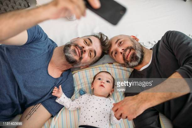 gay dads - gay rights stock pictures, royalty-free photos & images