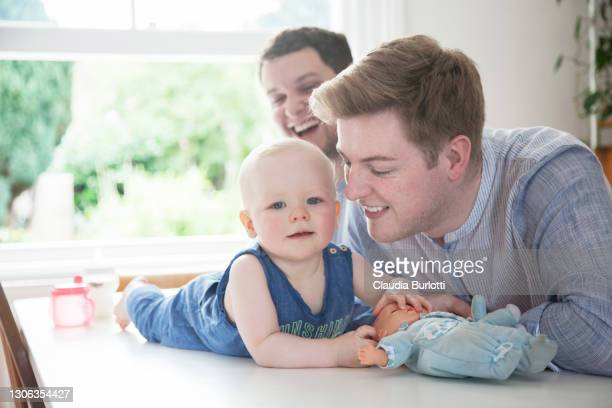 gay fathers and son - politics and government stock pictures, royalty-free photos & images