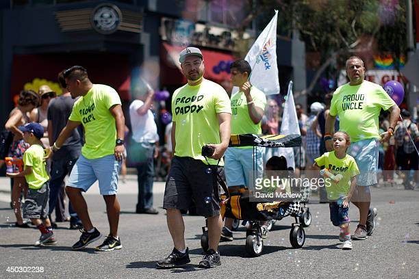 Gay fathers and their children march in the LA Pride Parade on June 8 2014 in West Hollywood California The LA Pride Parade and weekend events this...