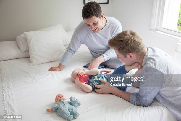 gay fathers and their son - politics and government stock pictures, royalty-free photos & images