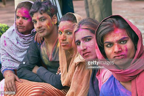 gay indian group watching holi festival - hermaphrodite stock pictures, royalty-free photos & images