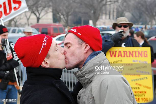 gay kiss as protest in front of preacher against homosexuality - fundamentalism stock photos and pictures
